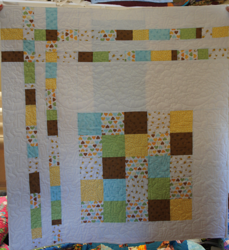 Baby Quilt with 2 longarm pantographs